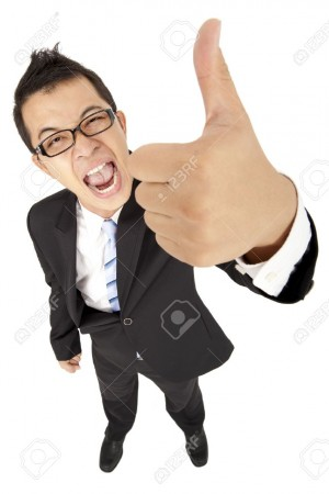 11567984-asian-businessman-with-thumb-up-Stock-Photo